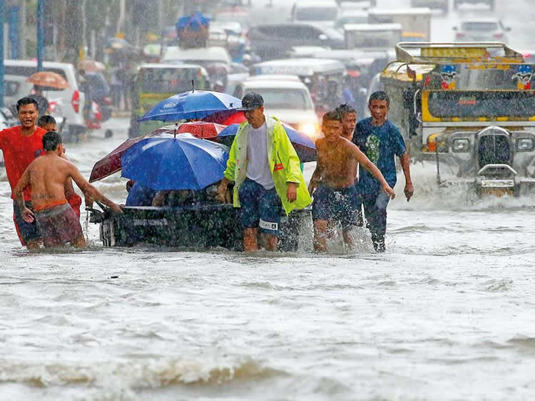 Flooding in Metro Manila streets. Photo: Associated Press