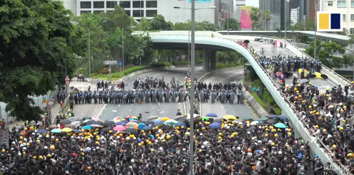 Student protesters and police face off in Hong Kong on July 1, 2019