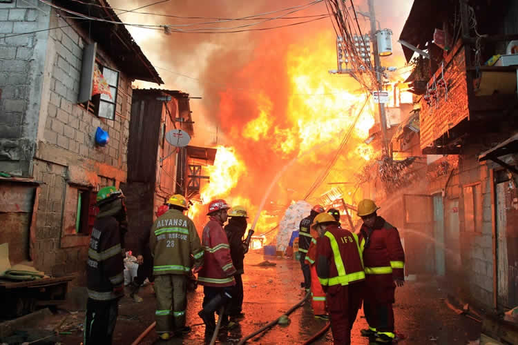 Narrow streets and side-by-side houses make many Philippine cities a tinderbox ready to burst into flames